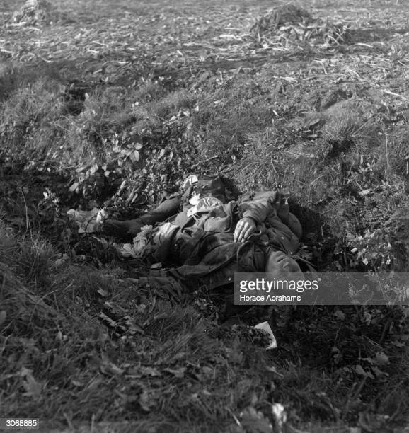 The corpse of a German soldier killed by the Polish army at Ginnekan near Breda in the Netherlands One of his legs has been blown off and lies on the...