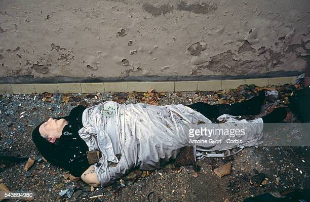 The corpse of an elderly Croatian woman lies in the deserted streets of Vukovar after a threemonth battle between the Croatian armed forces and the...