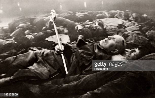 The corpse of Italian dictator Benito Mussolini holding a staff of office amidst a pile of other dead bodies including his mistress and 15 members of...