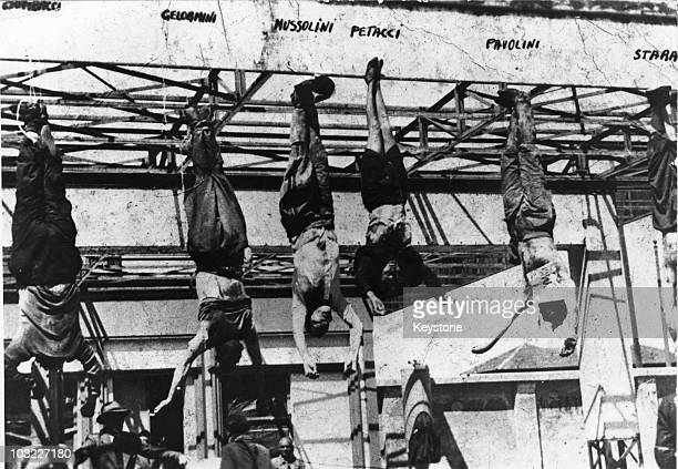 The corpse of Italian fascist leader Benito Mussolini hangs by his feet at a petrol station in Milan after his execution by partisans at Mezzegra...