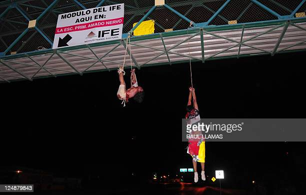 The corpses of a man and a woman hang from a pedestrian bridge in Nuevo Laredo Tabasco state Mexico on September 13 early morning Two bodies appeared...