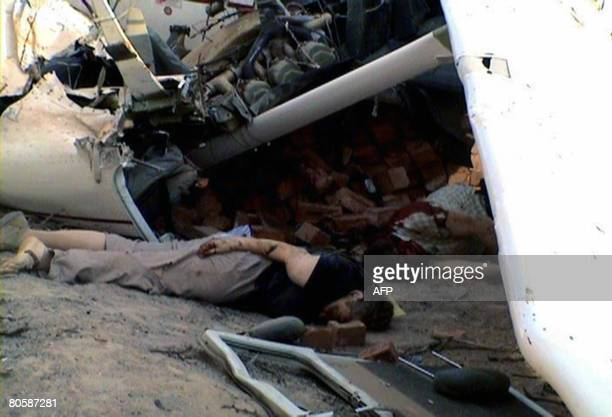 The corpses of French tourists lie next to the wreckage of an aircraft that crashed in Nasca 450 km south of Lima Peru on April 9 2008 The small...