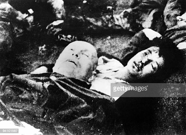 The corpses of Italian dictator Benito Mussolini and his mistress Claretta Petacci lie on the ground, April 28 after they were executed by Italian...