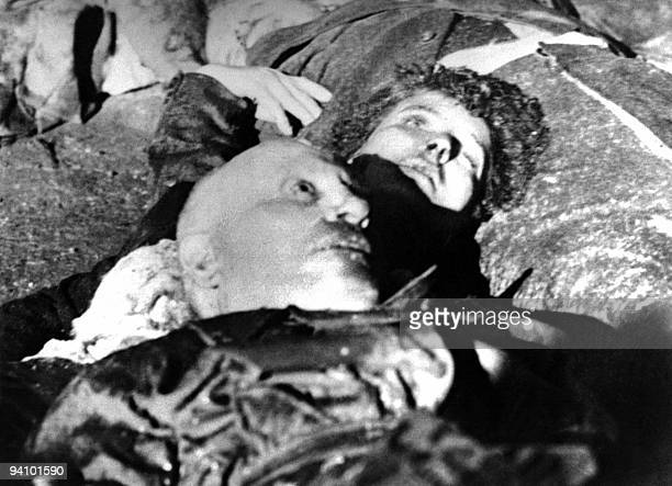 The corpses of Italian dictator Benito Mussolini and his mistress Claretta Petacci lie on the ground April 28 after they were executed by Italian...