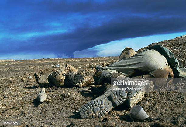 The corpses of two soldiers with the Iraqi armed forces lie on a battlefield in Fao, Iraq after a siege during the Iran-Iraq War.