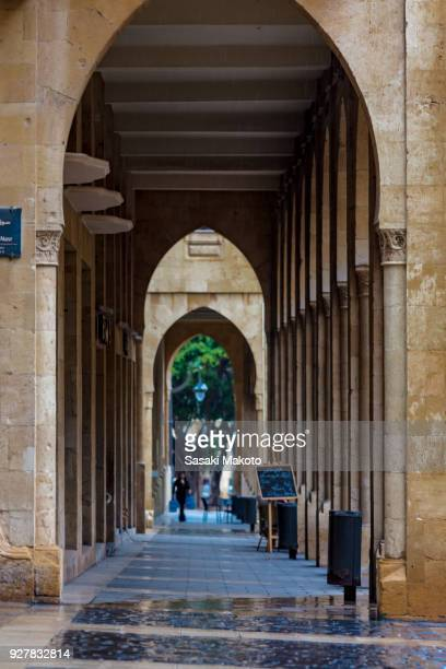 the corridor shaped with series of pillars and arches