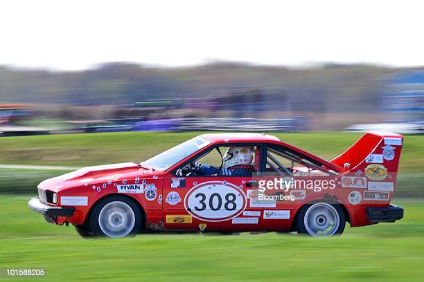 The Corsa Nostra Alfa Romeo is driven during the 24 Hour of LeMons American Irony race at Gingerman Raceway in South Haven, Michigan, U.S., on...