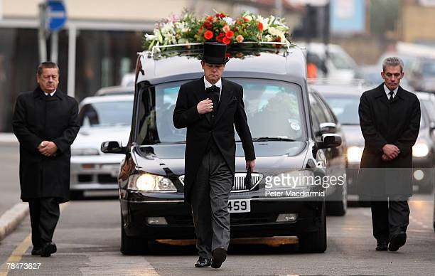 The cortege carrying the coffin of Meredith Kercher makes it's way to Croydon Parish Church South London on December 14 2007 Three people are being...