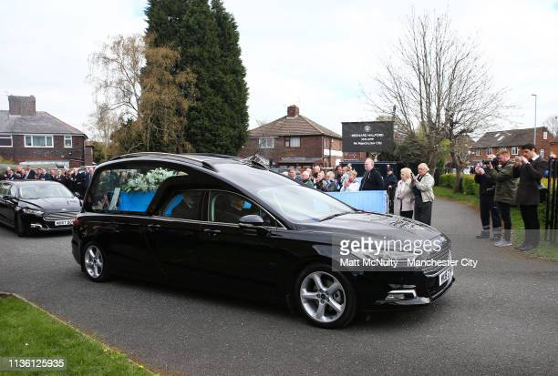 The cortege leaves the service at the Funeral of Manchester City Life President Bernard Halford at St Mary's Church in Manchester on April 10 2019 in...