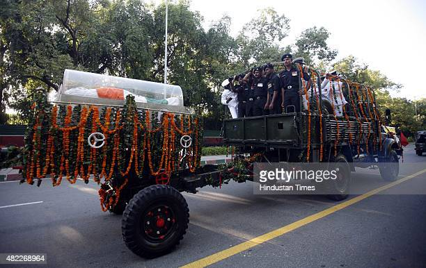 The cortege of President APJ Abdul Kalam on its way to the Delhi Airport from where a special aircraft will fly Dr Kalam's body to Rameswaram for...