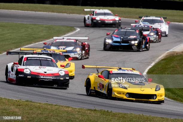 The Corvette C7R of Jan Magnussen of Denmark and Antonio Garcia of Spain leads a pack of cars during the IMSA WeatherTech Series race at Lime Rock...