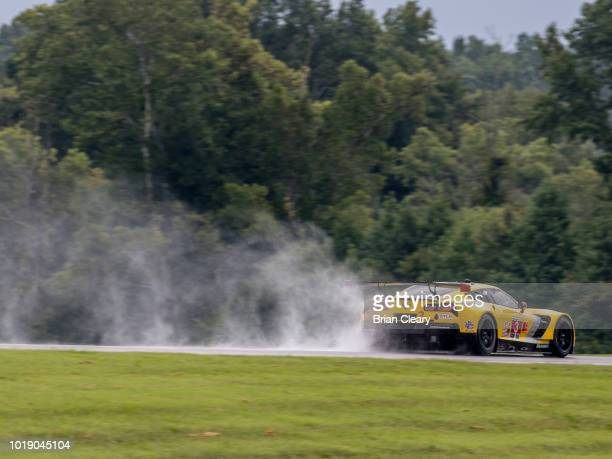 The Corvette C7R of Jan Magnussen of Denmark and Antonio Garcia of Spain races on the track during qualifying for the Michelin GT Challenge IMSA...