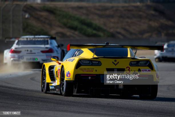 The Corvette C7R of Jan Magnussen of Denmark and Antonio Garcia of Spain races on the track during the American Tire 250 IMSA WeatherTech Series race...