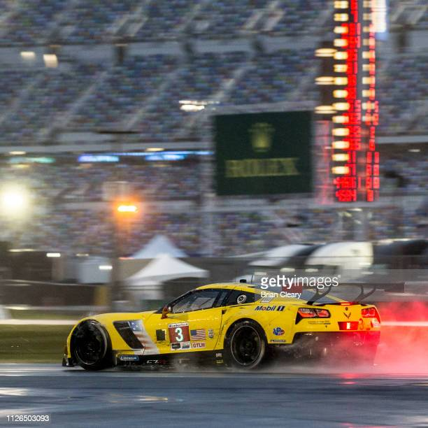 The Corvette C7R of Jan Magnussen of Denmark Antonio Garcia of Spain and Mike Rockenfeller of Germany races through the early morning rain during the...