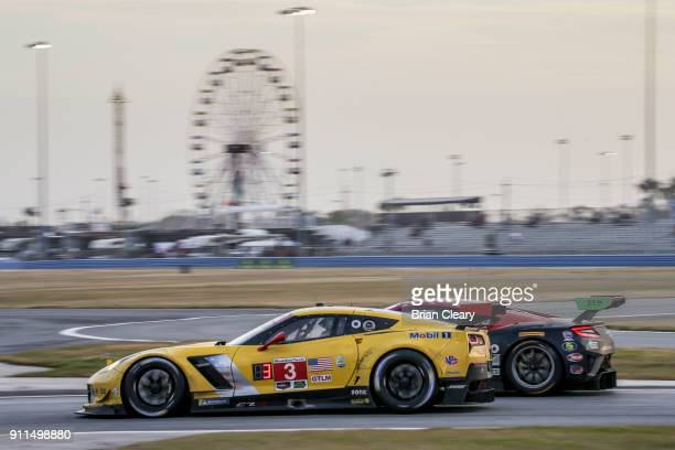 The Corvette c7R of Jan Magnussen of Denmark Antonio Garcia of Spain and Mike Rockenfeller of Gerrnany races on the track during the Rolex 24 at...