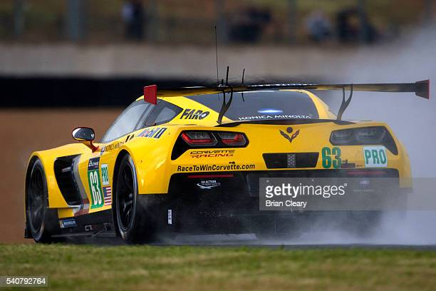 The Corvette C7R of Jan Magussen of Denmark Antonio Garcia of Spain and Ricky Taylor races in the rain during practice for the 24 Hours of Le Mans on...