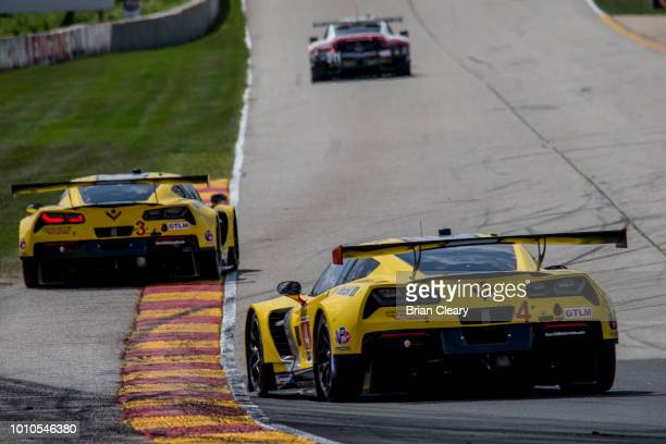 The Corvette C7R of Oliver Gavin of Great Britain and Tommy Milner drives behind the Corvette C7R of Jan Magnussen of Denmark and Antonio Garcia of...