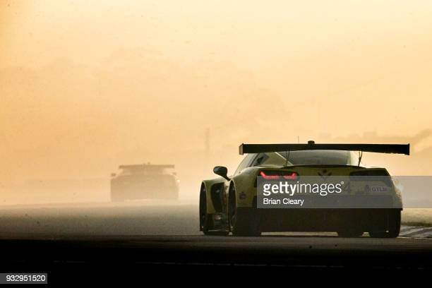 The Corvette C7.R of Oliver Gavin, of Great Britain, Tommy Milner, and Marcel Fassler, of Switzerland, drives on the track through heavy smoke from a...