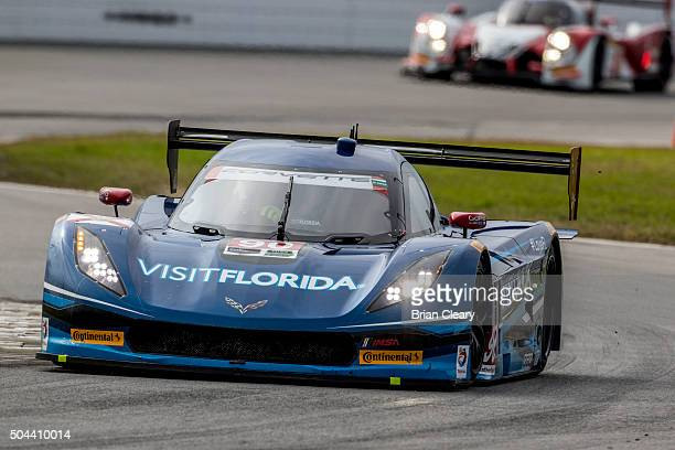 The Corvette DP of Marc Goosens Ryan Dalziel and Ryan HunterRaey leads another car during the Roar Before the 24 IMSA WeatherTech Series testing at...