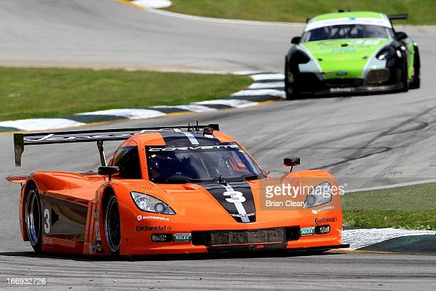 The Corvette DP of Pedro Lamy, Enzo Potolicchio, and Stephane Sarrazin is shown in action during practice. At Road Atlanta on April 18, 2013 in...