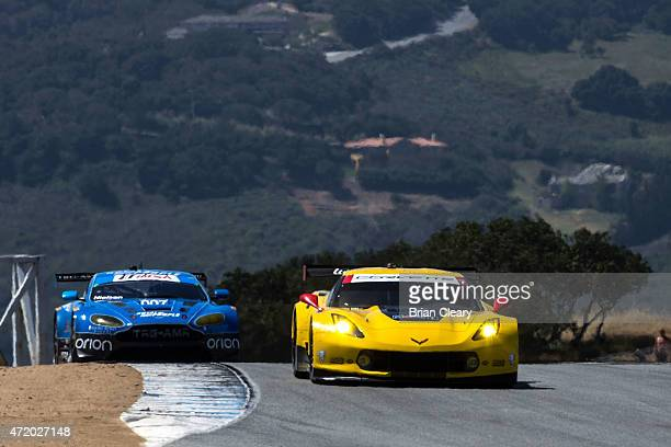 The Corvette of Jan Magnussen and Antonio Garcia drives on the track during practice for the IMSA Tudor Series race at Mazda Raceway Laguna Seca on...