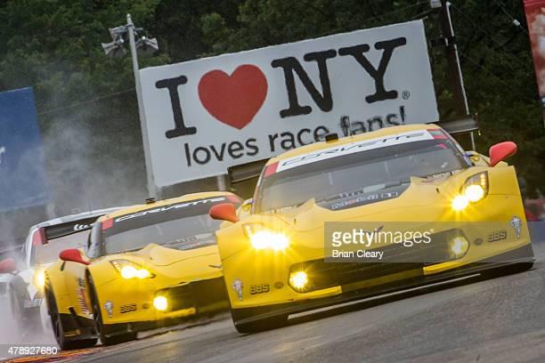 The Corvette of Jan Magnussen and Antonio Garcia races in the rain during the Sahlen's Six Hours of the Glen at Watkins Glen International on June 28...