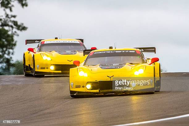 The Corvette of Oliver Gavin and Tommy Milner leads its team car of Jan Magnussen and Antonio Garcia during the Sahlen's Six Hours of the Glen at...