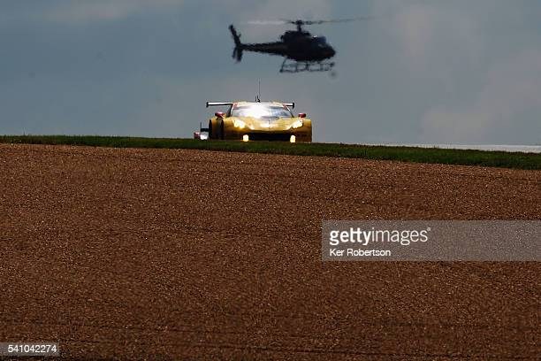 The Corvette Racing C7R of Antonio Garcia Jan Magnussen and Ricky Taylor drives during the Le Mans 24 Hour race at the Circuit de la Sarthe on June...
