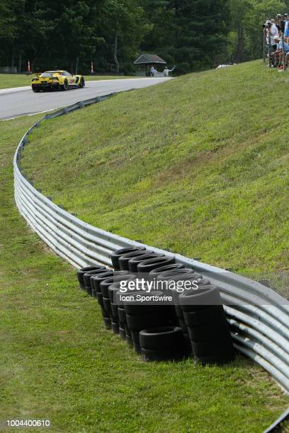 The Corvette Racing Corvette C7R driven by Antonio Garcia and Jan Magnussen races through Uphill track section while fans look on during the IMSA...