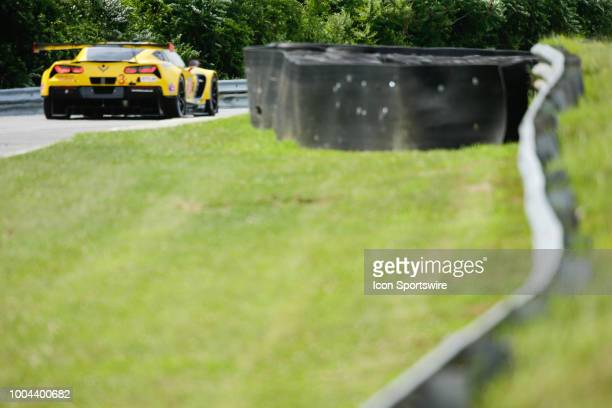 The Corvette Racing Corvette C7R driven by Antonio Garcia and Jan Magnussen enters West End curve during the IMSA Northeast Grand Prix on July 21 at...