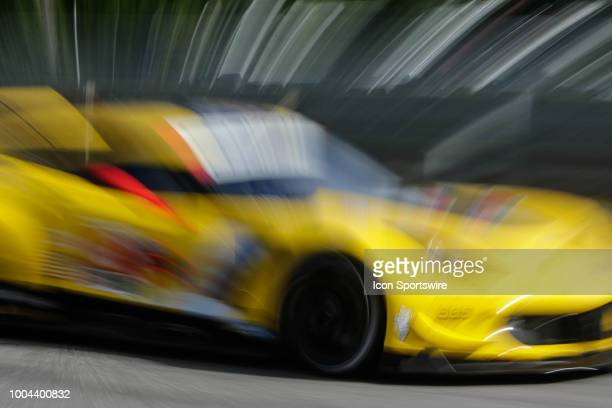 The Corvette Racing Corvette C7R driven by Antonio Garcia and Jan Magnussen races during qualifying for the IMSA Northeast Grand Prix on July 21 at...
