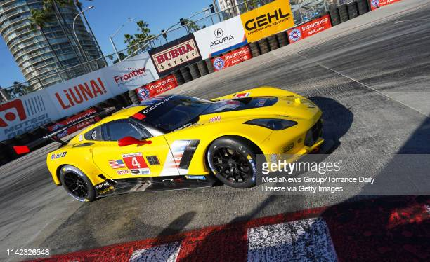 The Corvette Racing team of drivers Oliver Gavin and Tommy Milner drives around the hairpin during qualifying in the IMSA WeatherTech race series in...