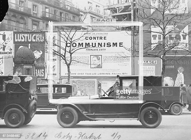 The cosmetics seller Francois Coty advertises his book on a large billboard which he emphasises is an anticommunist work