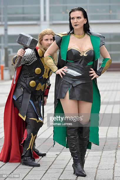 The 'Cosplayer' Julia in the role of 'Lady Loki' pose with the her friend in the role of 'Thor' at the Frankfurt Book Fair on October 12, 2014 in...