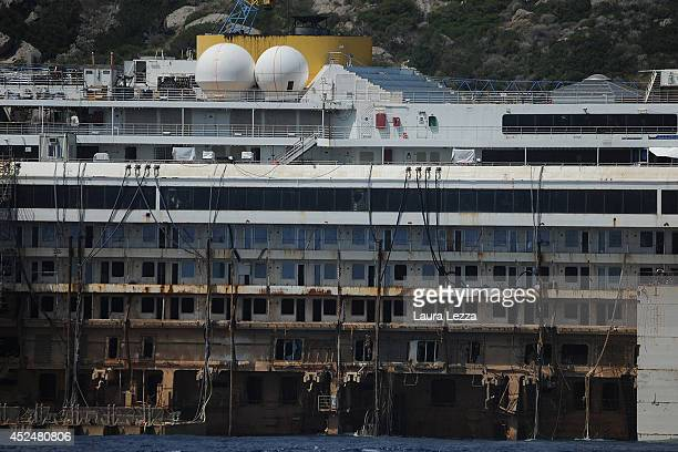 The Costa Concordia is visible from the submerged port side of the wrecked cruise ship as it sits in the water during the last stage of refloating...