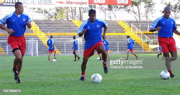 The costarrican soccer player Erick Lonis Steven Bryce and Austin Berry are seen practicing 26 March 2002 during training in San Jose Costa Rica Los...