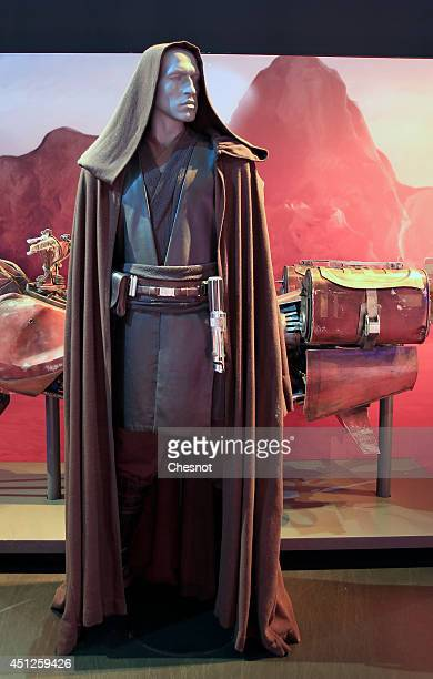 The costume of character Anakin Skywalker from the Star Wars film series is displayed during the exhibition 'Star Wars Identities' at the Cite du...