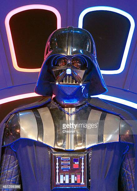The costume of character Darth Vader from the Star Wars film series is displayed during the exhibition Star Wars Identities at the Cite du Cinema on...