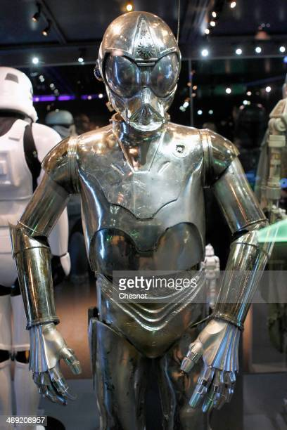 The costume of character RA7 from the Star Wars film series is displayed during the presentation of the exhibition Star Wars Identities at the Cite...