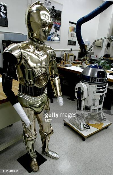 The costumeS for C3PO and R2D2 from Star Wars Return of the Jedi lay on a table during restoration at the Smithsonian Institution's National Museum...