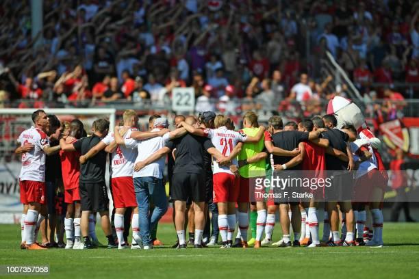The Cottbus team celebrates after winning the 3. Liga match between FC Energie Cottbus and F.C. Hansa Rostock at Stadion der Freundschaft on July 29,...