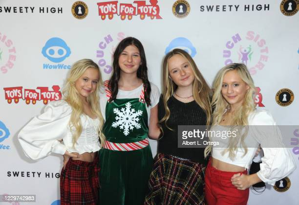 """The Couch Sisters pose with Mackenzie Hancsicsak of NBC's """"This Us"""" at the 2nd Annual Toys For Tots Toy Drive held at The Industry Loft Space on..."""