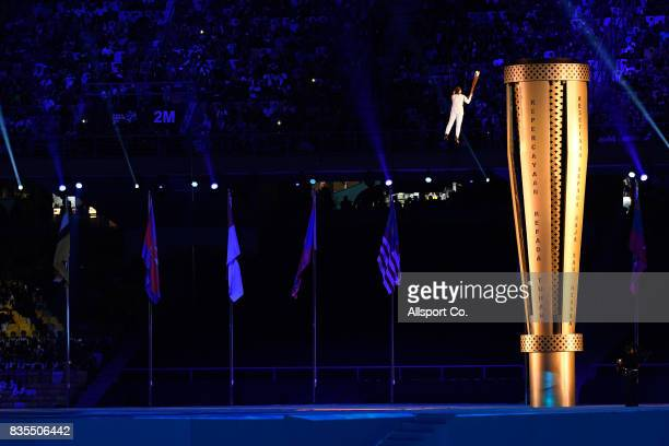 The Couldron is lgihted by Malaysian diver Nur Dhabitah Sabri during the opening ceremony at the Bukit Jalil National Stadium as part of the 2017 SEA...