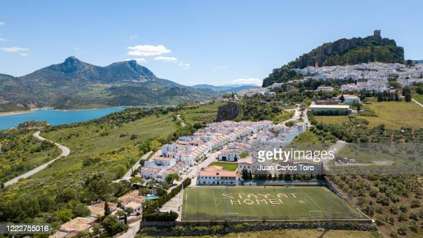 The council of Zahara de la Sierra use bales of hay to write a message saying 'stay at home' on a local football pitch on April 29, 2020 in Zahara de...