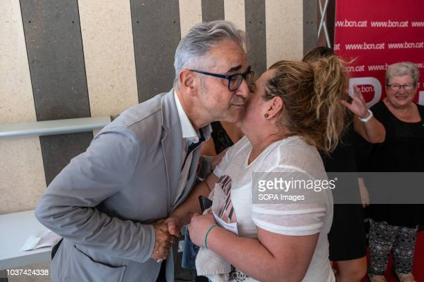 The councilor of housing of the city council of Barcelona Josep Maria Montaner is seen hugging with a woman during the hand over event Handing over...