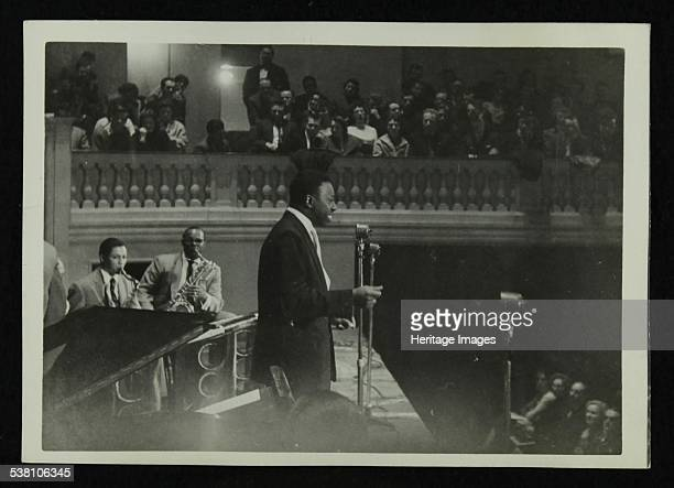 The Count Basie Orchestra in concert c1950s Joe Williams on vocals Artist Denis Williams