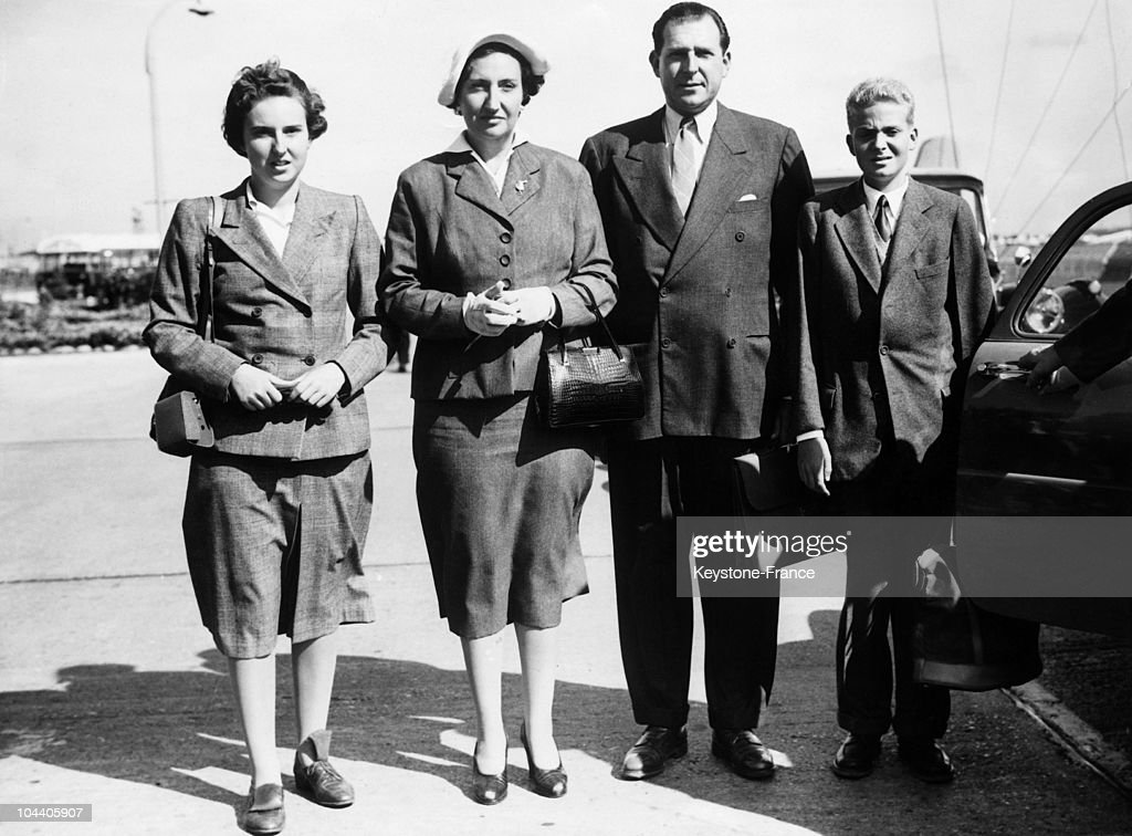 The count of Barcelona DON JUAN and his wife MARIA de la MERCEDES of BOURBON and their two children : MARIA del PILAR of Spain (left) and DON JUAN CARLOS, King of Spain-to-be (right) in London airport. They were going to Scotland to hunt the red grouse.