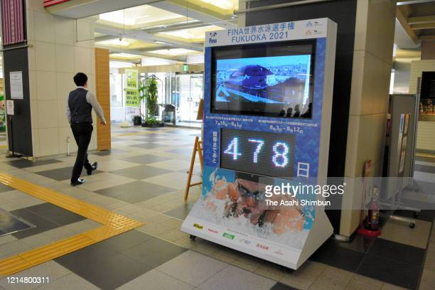 The countdown board of the FINA Swimming Championships is seen a day after the Tokyo 2020 Olympic and Paralympic Games postponement was announced due...