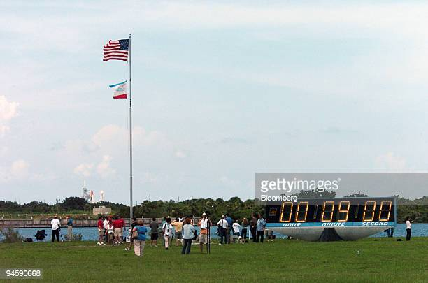 The countdown clock in the press area is held at nine minutes to launch as the Space Shuttle Discovery is seen in the distance on the launchpad at...