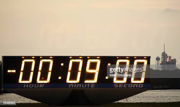 The countdown clock stops with nine minutes left as space shuttle Endeavour sits on launch pad 39B May 30 2002 at Kennedy Space Center FL Weather...